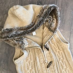 Cable knit vest with faux fur hood